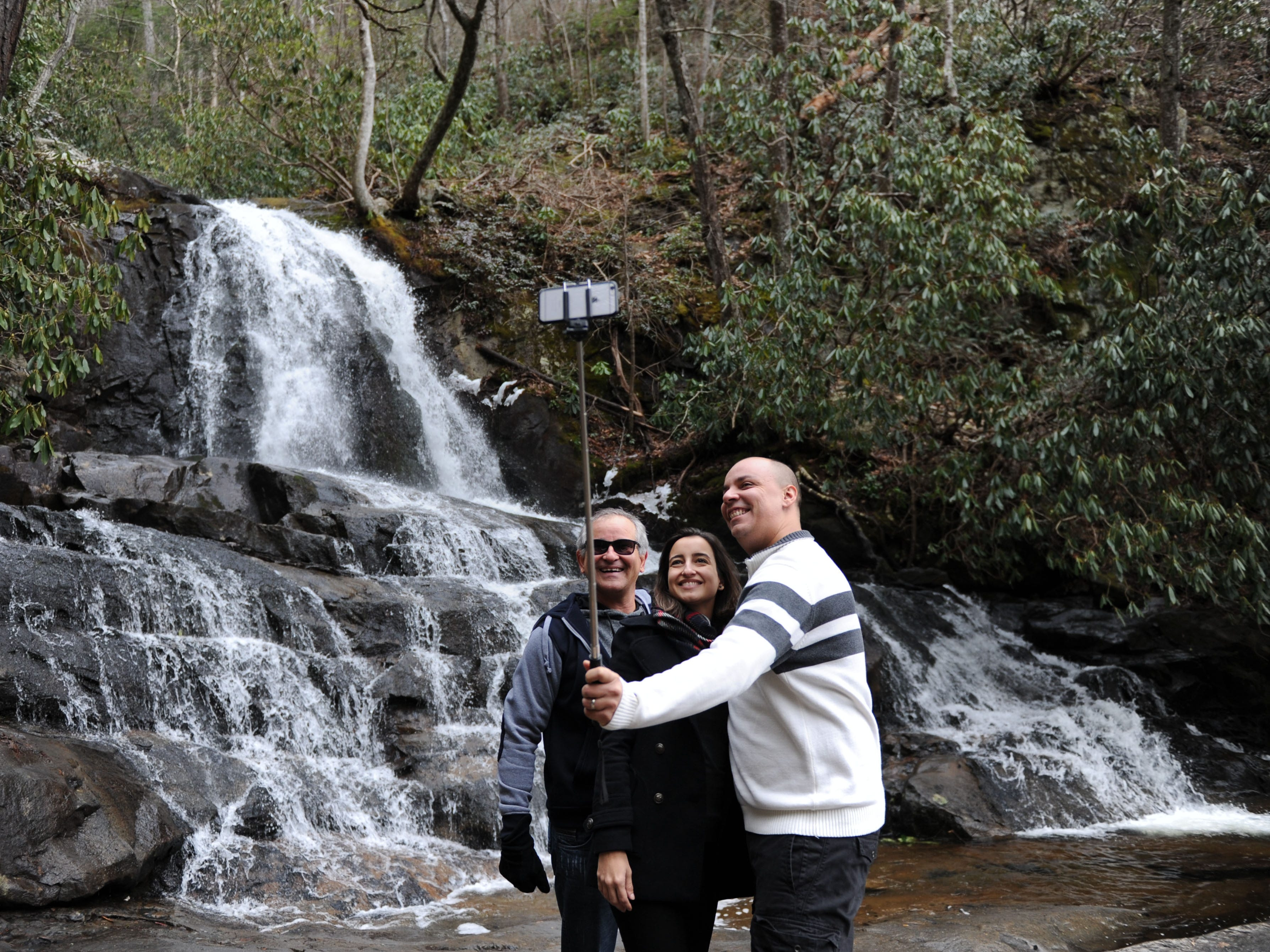 Luiz, left, Camila, and Fernando Nunez from Florida document their hike to Laurel Falls in the Great Smokey Mountains National Park on, Jan. 26, 2016.  The family, originally from Brazil, are on a week-long vacation in the Smokies. (CAITIE MCMEKIN/NEWS SENTINEL)