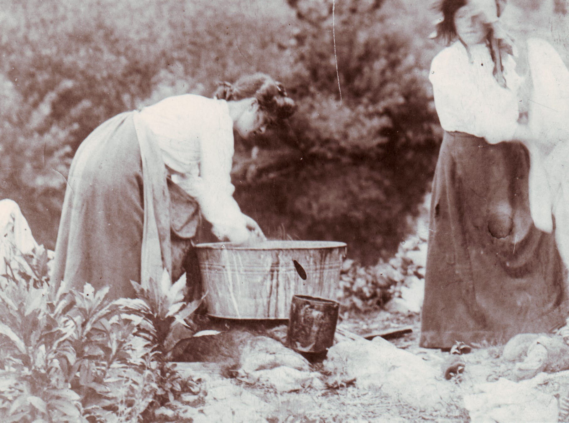 Kate Shields and Harriette Moody washing clothes on on washday in Cades Cove, circa 1915.