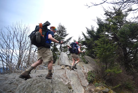 Thru-hikers Larry and Sue Smith, from left, hike along the Appalachian Trail towards Clingmans Dome from Double Springs Shelter in Great Smoky Mountains National Park on Wednesday, April 20, 2016. (ADAM LAU/NEWS SENTINEL)