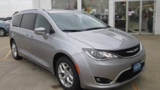 Knoxville police say a Chrysler Pacifica with the Kentucky license plate 246-XYS was stolen Monday during a carjacking on 13th Street.