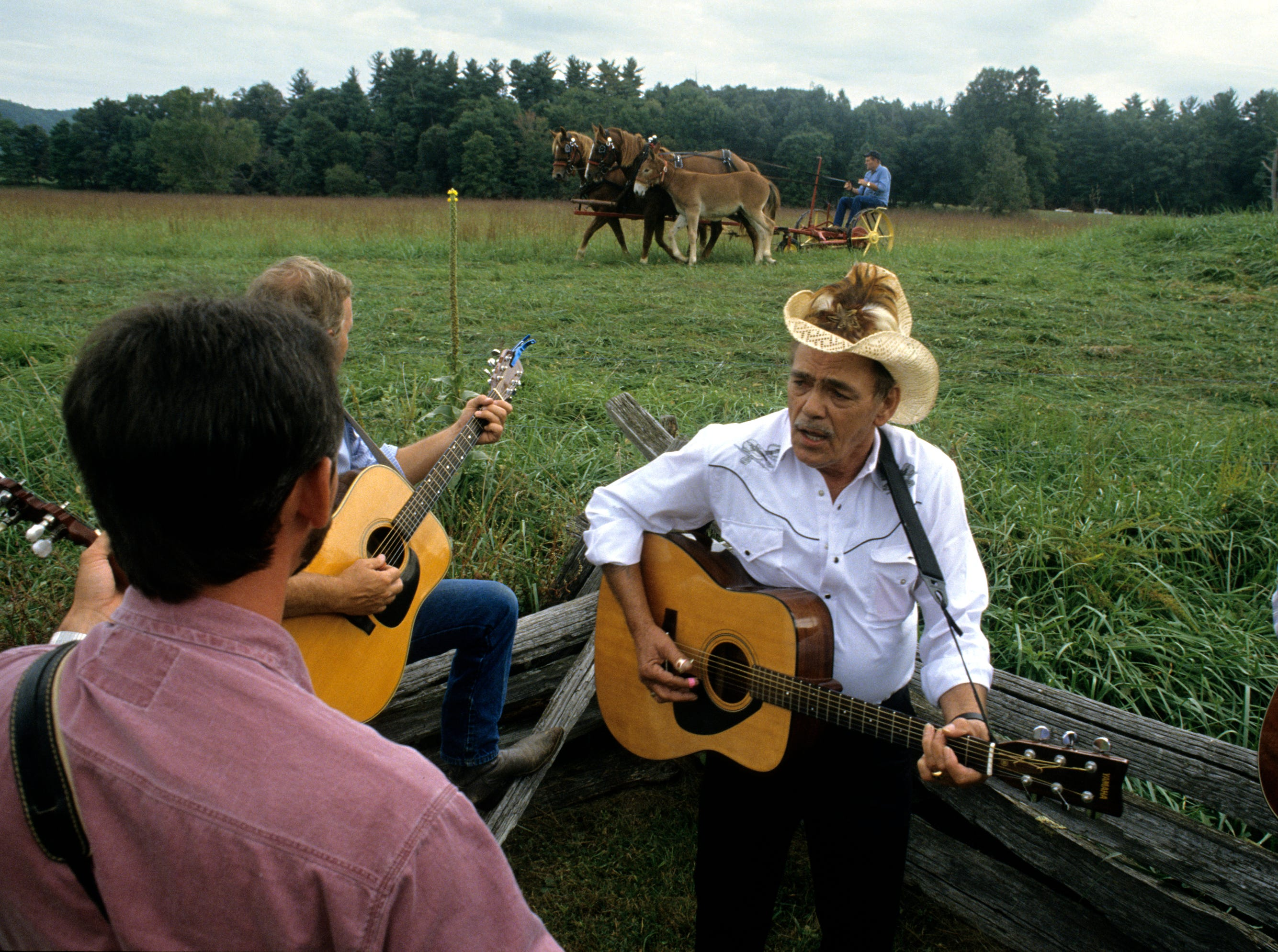 """Junior Gibson takes the lead singing """"Why I Love Jesus"""" during Old Timers Day in Cades Cove on Sept. 29, 1992 in the Great Smoky Mountains National Park. """"That's what I cut my teeth on,"""" said Gibson about the gospel tune."""