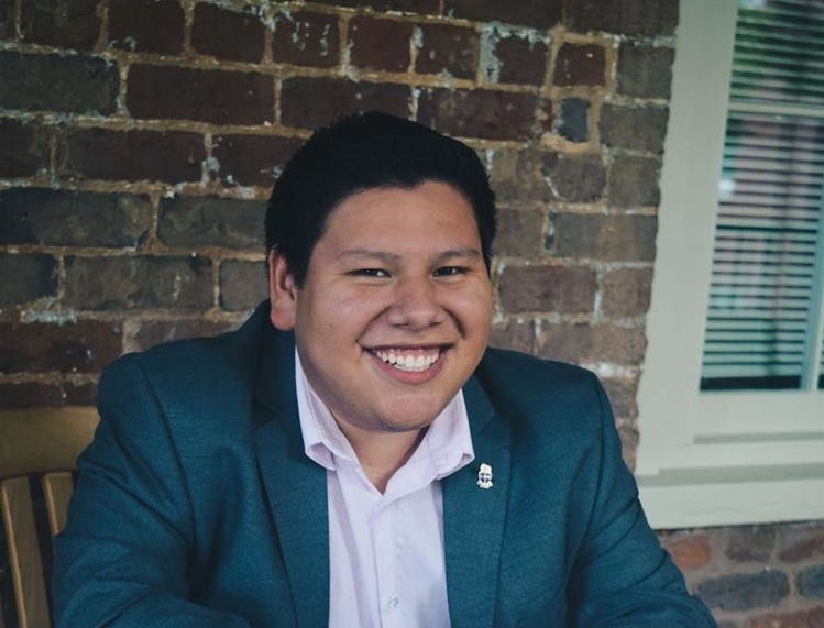 "Daniel Herrera, 26, 5'4,"" law student at Duncan School of Law. Herrera is studying to be a tax attorney, though he ultimately aspires to become a judge. The former North Carolinian served on the Keep Charlotte Beautiful committee. His interests include music, good food and great wine, and he loves discussions about life goals and politics."