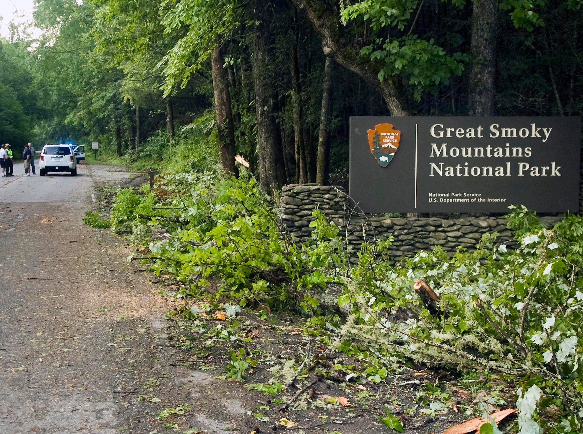 Storm damage is seen at the entrance to the Great Smoky Mountains National Park Friday in Townsend. Two park visitors were killed and others injured by a violent storm that swept through the Cades Cove area Thursday evening. (J. Miles Cary/News Sentinel)