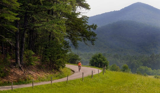 Mary Barry from Houston, TX rides along the 11-mile loop of Cades Cove in the Great Smoky Mountains National Park.