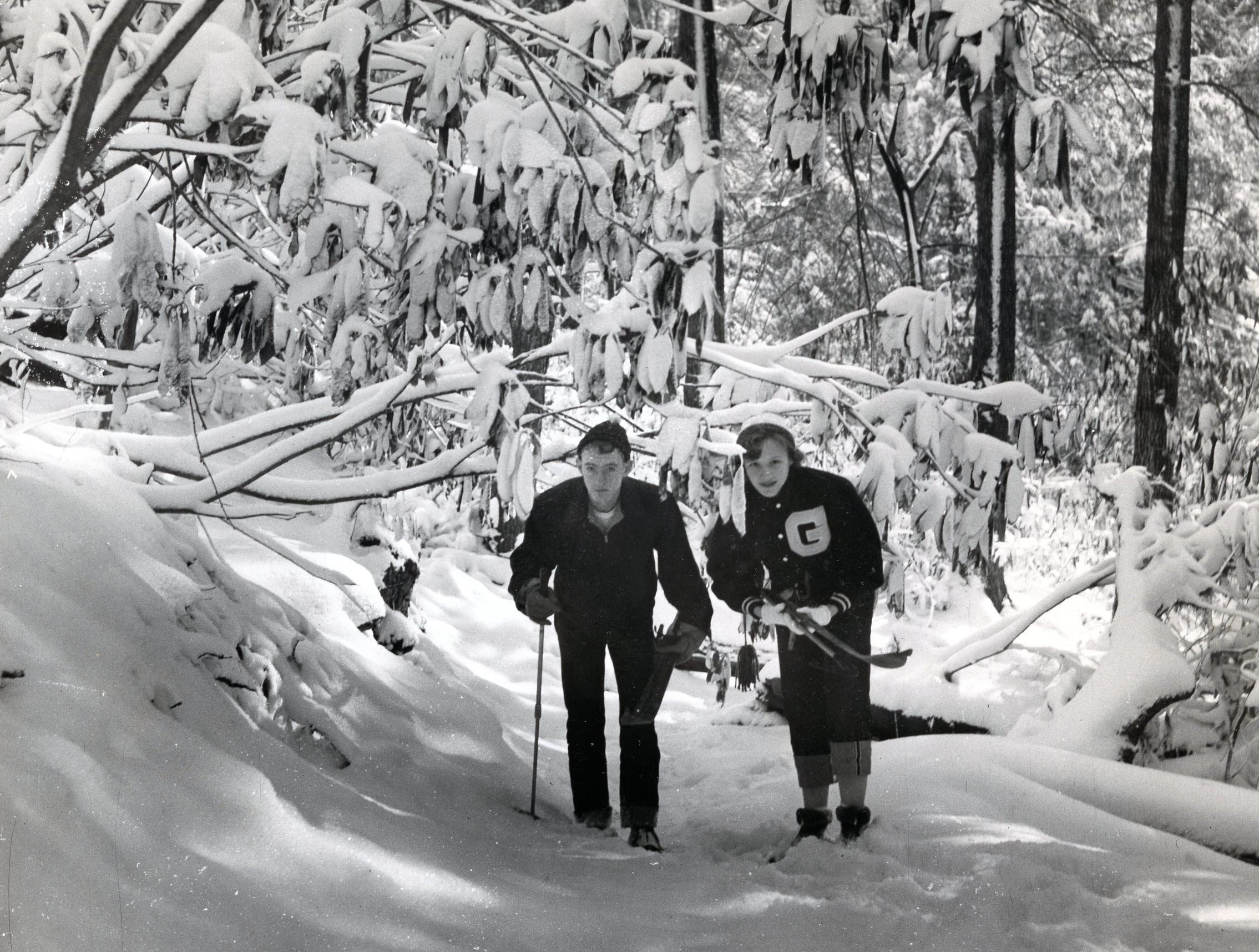 Jim Huff, 17 and Connie Cox, 15 explore the snow in the Smokies with Pi Delta Phi School in Gatlinburg, December 1955.