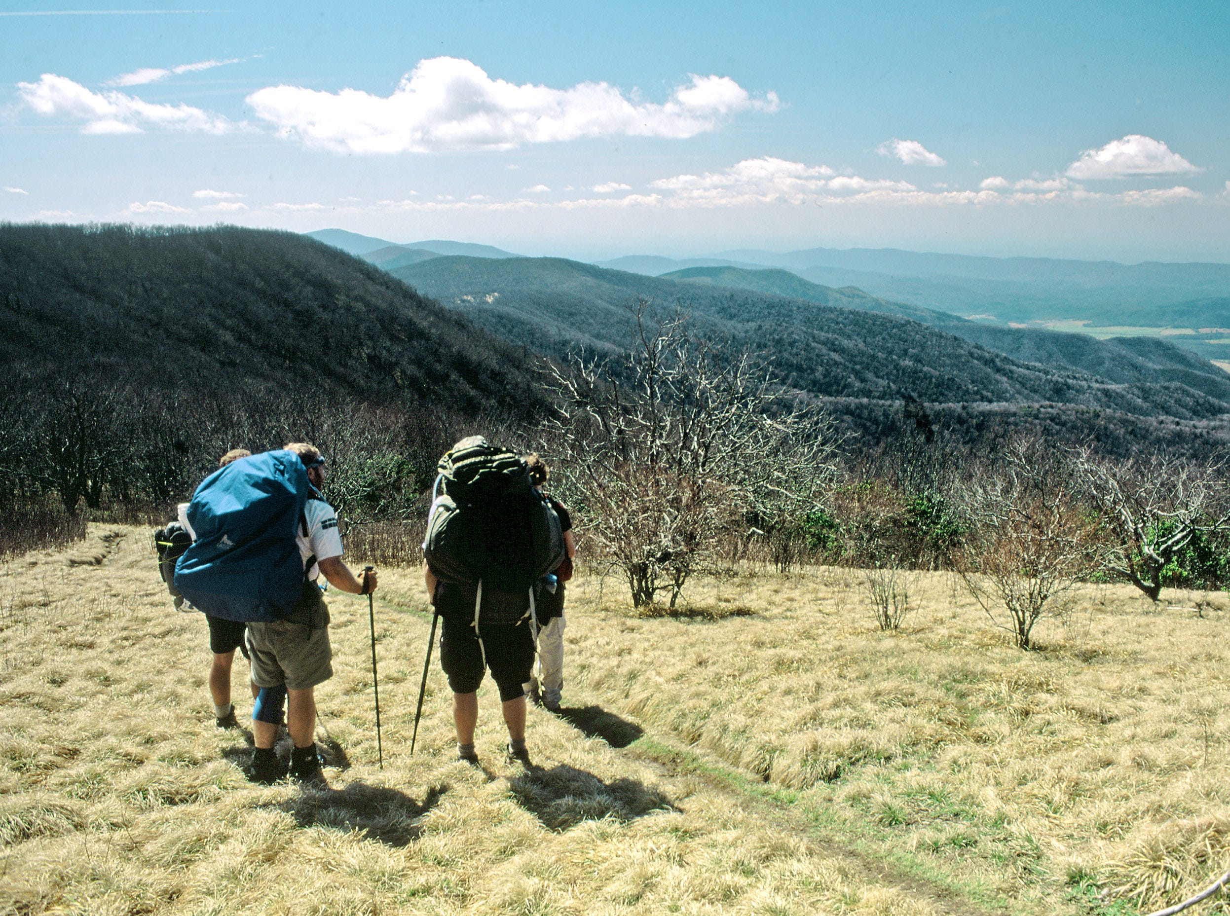 Appalachian Trail hikers take in a view of Cades Cove in April 2003 in the Great Smoky Mountains National Park. This portion of the AT is part of the hike from Newfound Gap to the Hazel Creek embayment via the Jenkins Ridge Trail.
