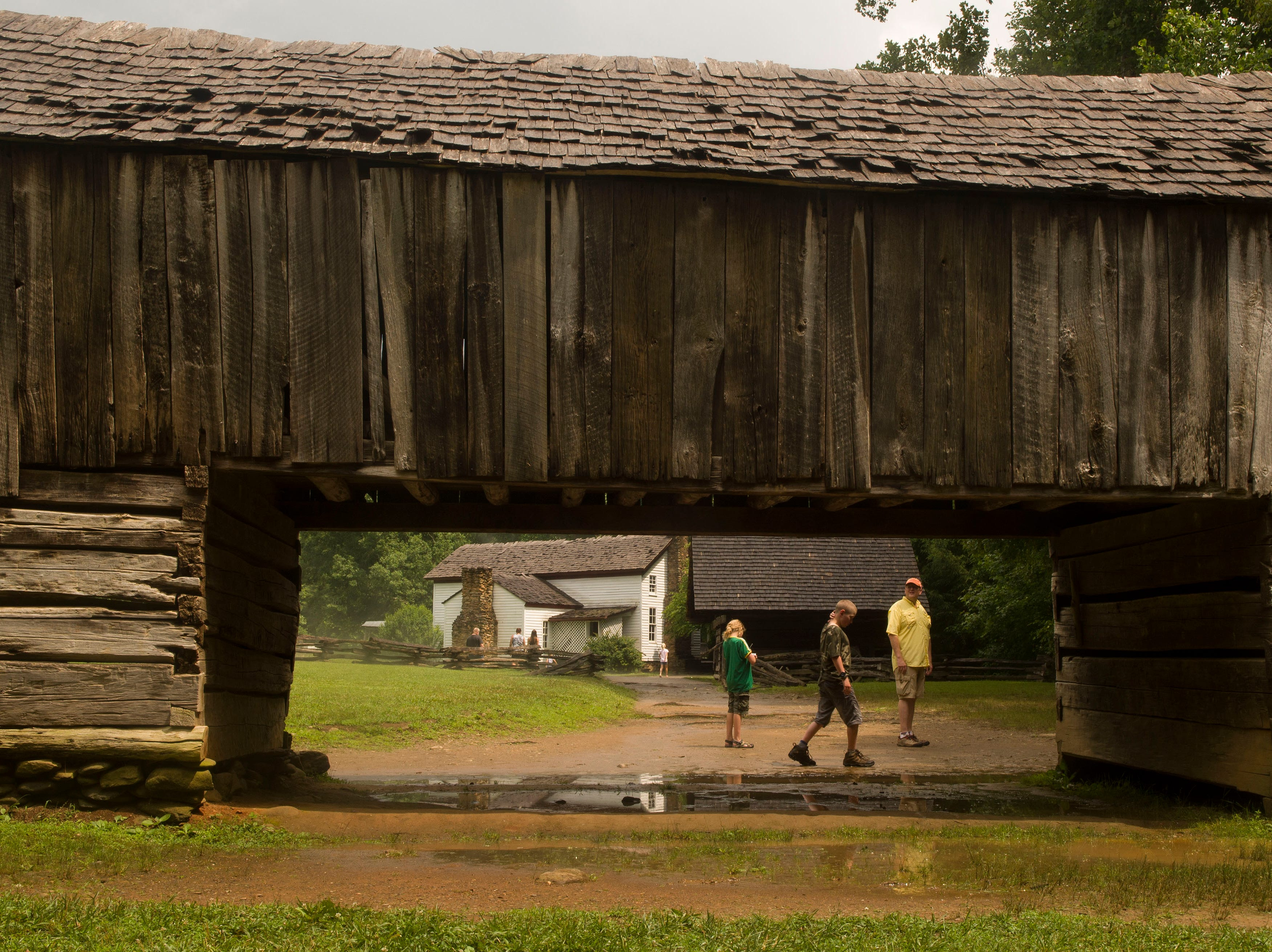 A barn and out buildings at the Greg-Cable house, and Grist mill in Cades Cove Wednesday, June 25, 2014Sevierville businessman offers biplane rides.(J. MILES CARY/NEWS SENTINEL)