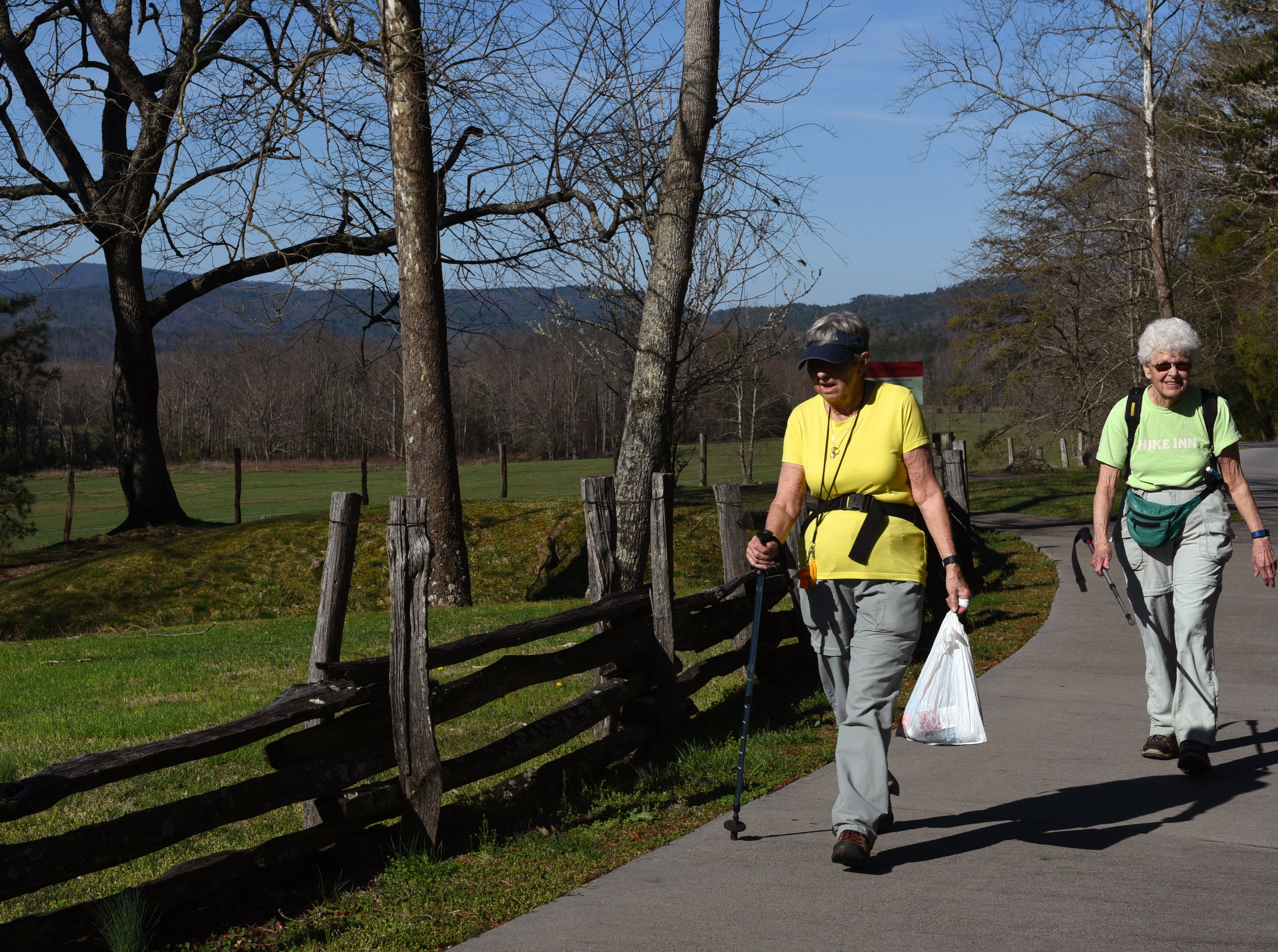 """Lois Costanza and Barbara Adams, right, finish their hike of the short loop in Cades Cove Tuesday, Mar. 15, 2016. Costanza is from Maryville and Adams is from New York. Adams added, """"It must be spring break cause I've never seen so many cars in here.""""  (MICHAEL PATRICK/NEWS SENTINEL)"""