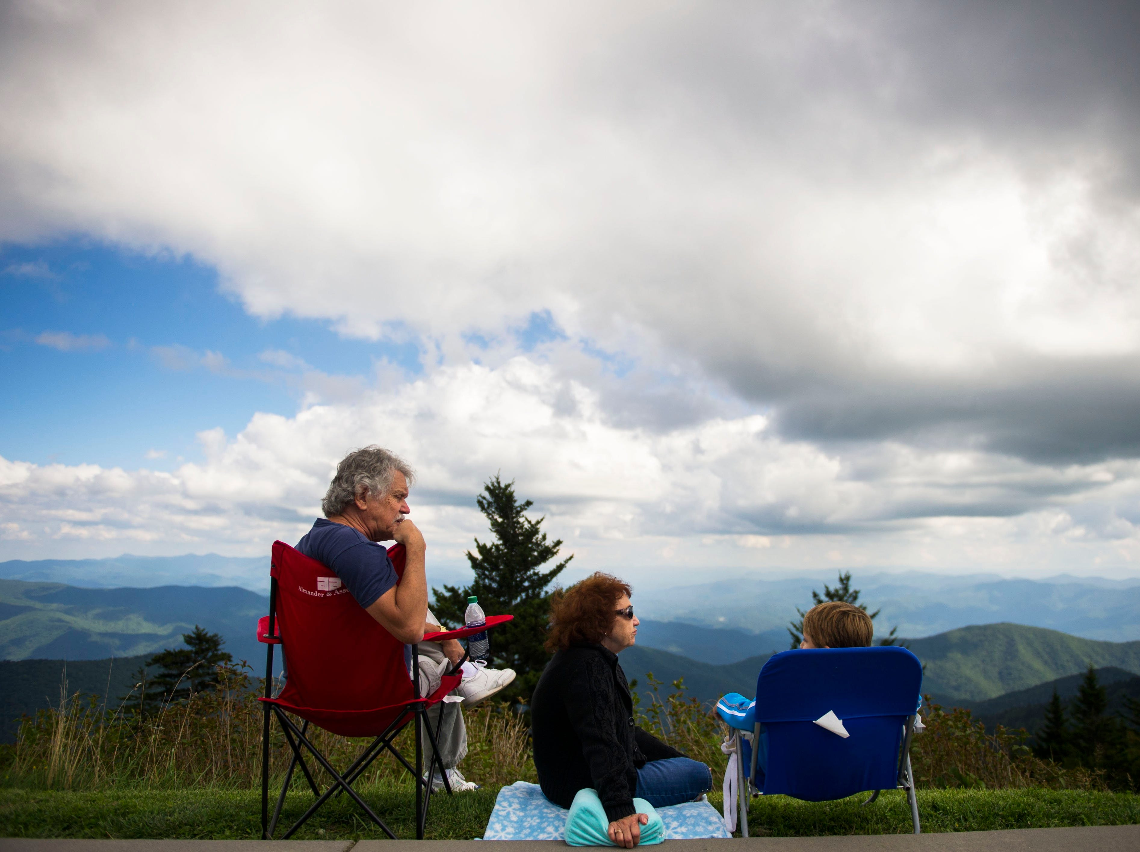 Bob and Sandra Farrell of Knoxville sit with their great-grandson who they are raising, Neo Waller, 6, in Great Smoky Mountains National Park near Clingmans Dome on Saturday, Sept. 3, 2016. It was Neo's first time in the mountains. (CAITIE MCMEKIN/NEWS SENTINEL)