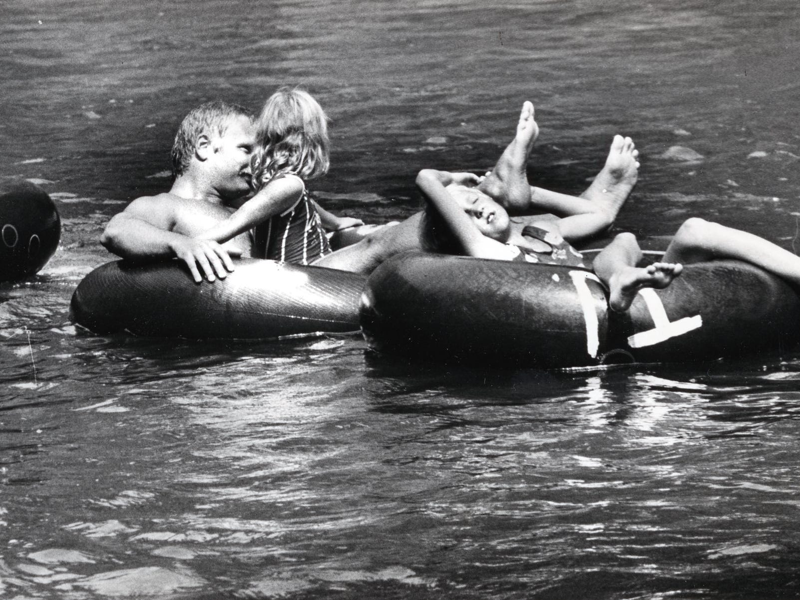 """With temperatures near 100 degrees, Little River in the """"Y"""" in the Great Smokey Mountains was filled with children and adults floating down the river. August, 1988"""