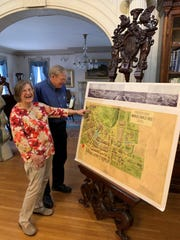Bob and Ellie Haan look over a map of the 1904 St. Louis World's Fair at the Haan Mansion Museum of Indiana Art, 920 E. State Street, in Lafayette. The fair was spread out over 1,200 acres and 1,500 buildings, making it twice the size of the 1893 Chicago World's Fair.