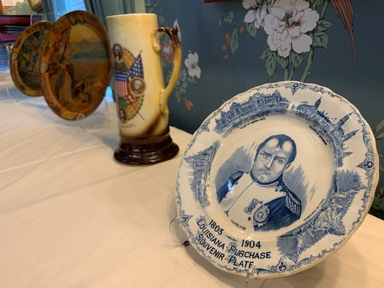 """The special exhibition """"St. Louis World's Fair: Celebrating 115 Years,"""" opening Jan. 26 at the Haan Mansion Museum of Indiana Art, includes commemorative plates, platters and cups from the event."""