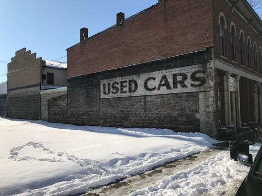 When the former R&M Wholesale building came down at 1007 Main St., this piece of advertising history was revealed on the side of what it now Fuel Coffee Shop. The lot was home to at least three car dealers before World War II. A firm called Bearing Point plans to building a new project on the lot.