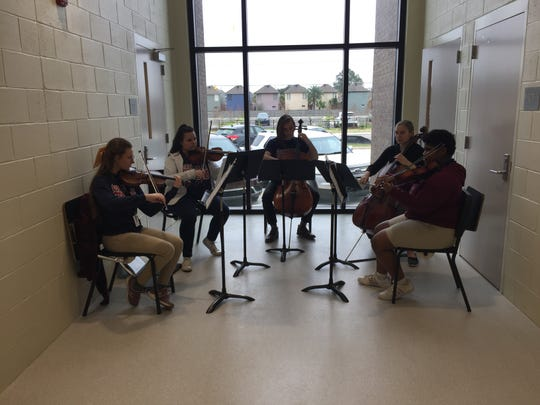 Performing arts academy students perform Monday at the ribbon cutting ceremony for the new building at Comeaux High School.
