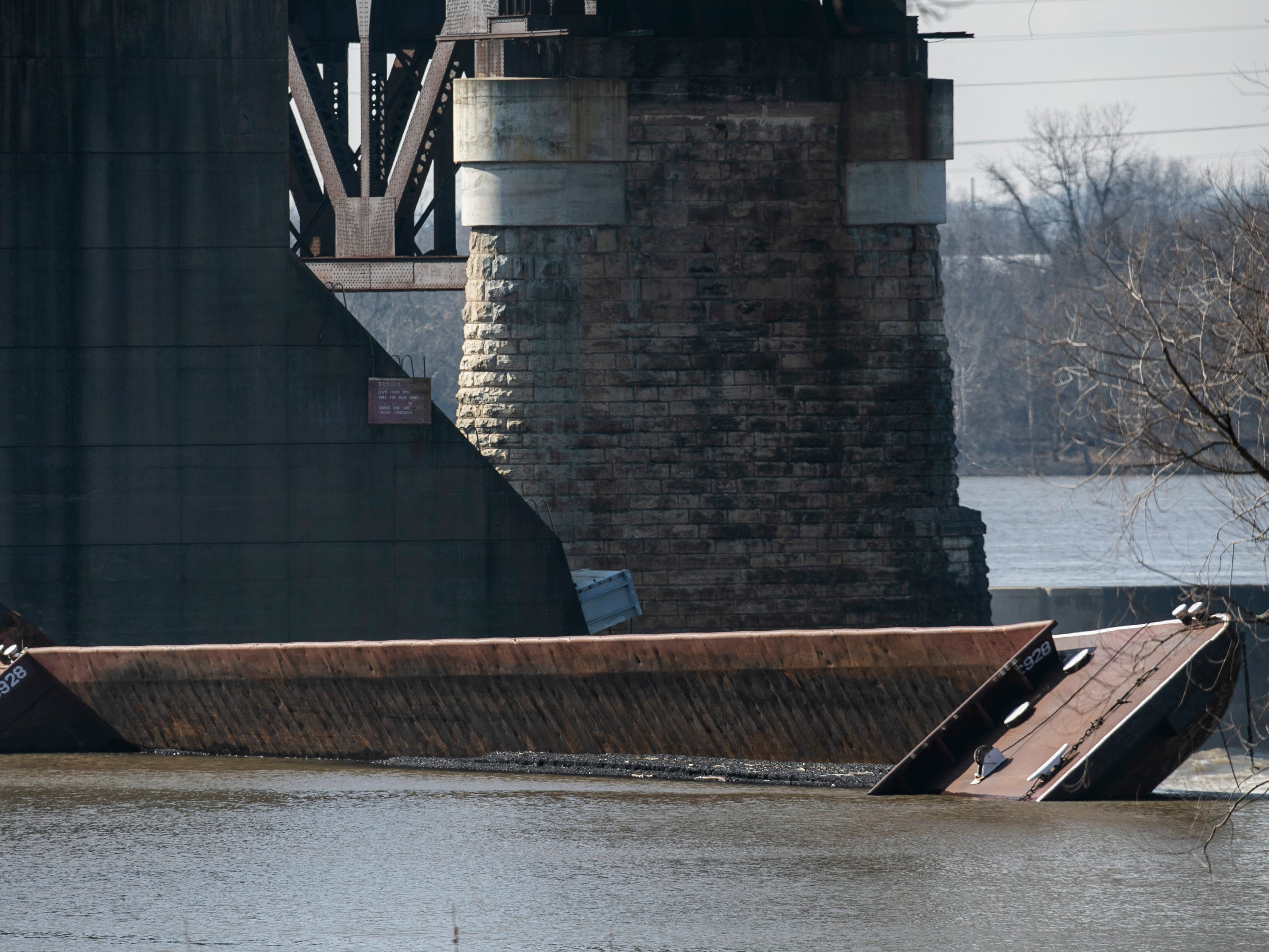 Four barges are still partially underwater and can be seen from Clarksville. Crews are still trying to recover those barges as well as the ones that have sunk. January 14, 2019