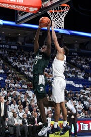 Gabe Brown drives the ball to the basket as Penn State's Josh Reaves defends during the second half of MSU's 71-56 win in State College.