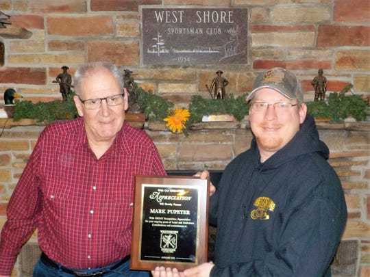 From left: Mark Pupeter accepts his special achievement award from Westshore Sportsmen's Club President Mike Krizizke. The award reads: 'With great recognition, appreciation for your ongoing years of loyal and dedicated support, contributions and commitment to Westshore Sportsmen's Club, Two Rivers.'