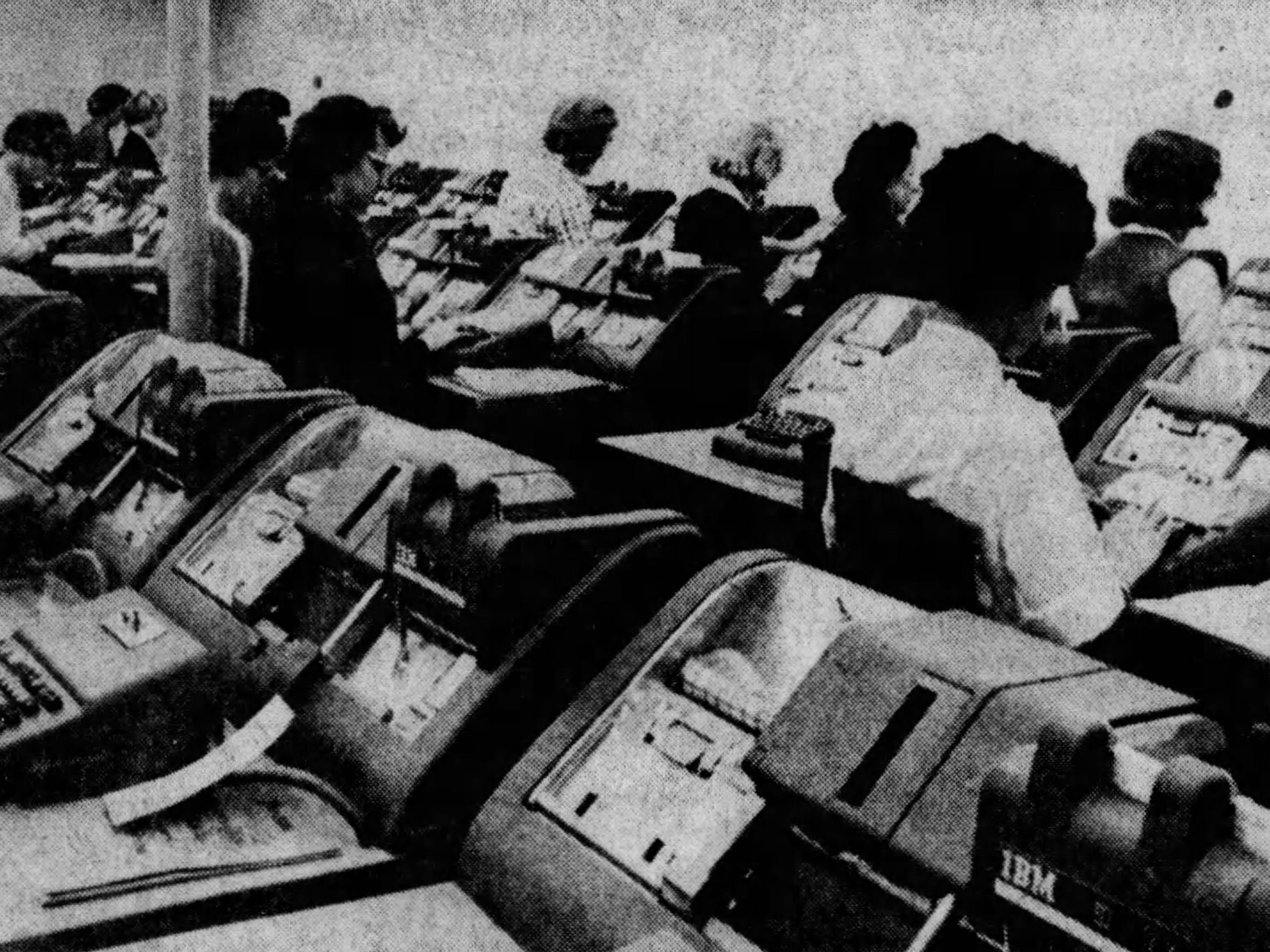 Operators key-punch information from incoming orders into about 60 IBM machines at Figi's Inc., sending the orders on their way to data processing equipment for mailing labels, order acknowledgements and invoices in this Nov. 13, 1964, photo.