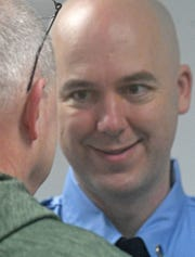 Shawn Yerian accepts well-wishes after being promoted to lieutenant Monday morning.