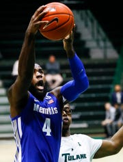 Memphis forward Raynere Thornton drives for a layup against the Tulane defense during action in New Orleans, Sunday, January 13, 2019.