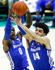 Memphis teammates Kyvon Davenport (left) and Isaiah Maurice (right0 fight each other for a rebound during action against Tulane in New Orleans, Sunday, January 13, 2019.