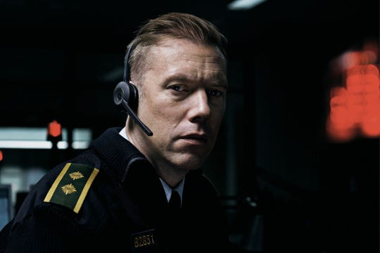 "Jakob Cedergren is a police officer struggling to foil a kidnapping while confined to a desk in  ""The Guilty,"" which screens Wednesday at the Ridgeway Cinema Grill."