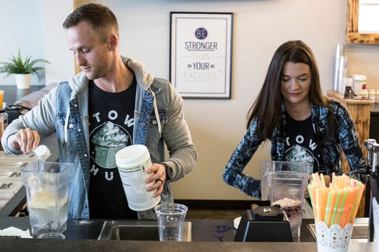 January 14 2019 - Co-owners Seth, left, and Cymber McMurry make drinks while working at Nutrition Hub at 9087 Poplar Avenue in Germantown. Nutrition Hub serves meal-replacement shakes, aloe shots, and energy teas.