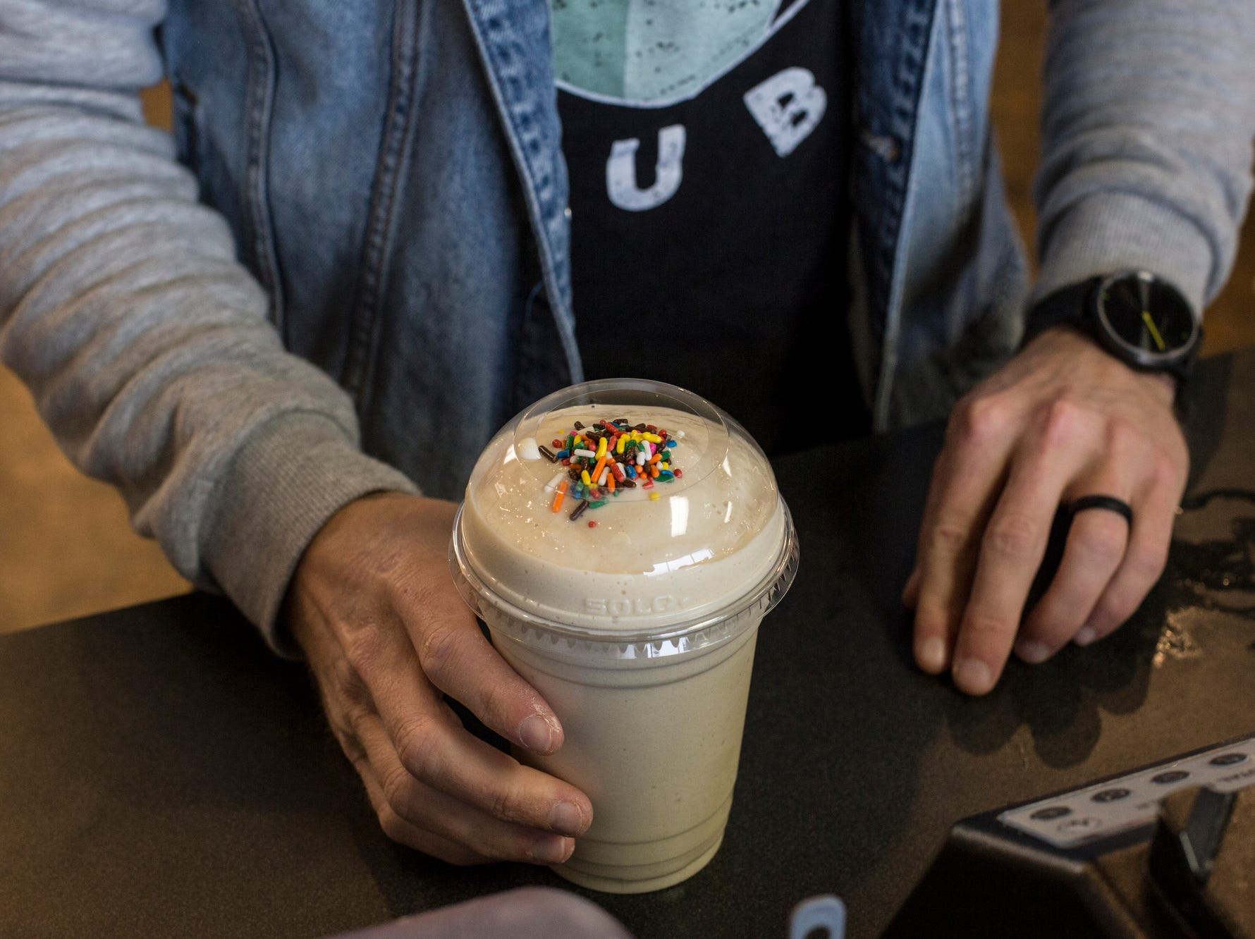 January 14 2019 - Seth McMurry creates a birthday cake shake at Nutrition Hub in Germantown. Nutrition Hub serves meal-replacement shakes, aloe shots, and energy teas.