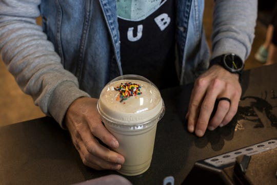 January 14 2019 - Seth McMurry creates a birthday cake shake at Nutrition Hub in Germantown. Nutrition Hub serves meal-replacement shakes, aloe shots, and energy teas. Nutrition Lounge in Lakeland is a sister restaurant to Nutrition Hub.