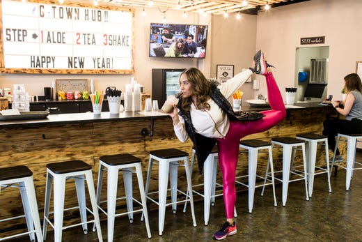 January 14 2019 - Regina Buckner poses for a picture for her social media accounts while at the Nutrition Hub co-owned by Seth and Cymber McMurry. Nutrition Hub serves meal-replacement shakes, aloe shots, and energy teas.