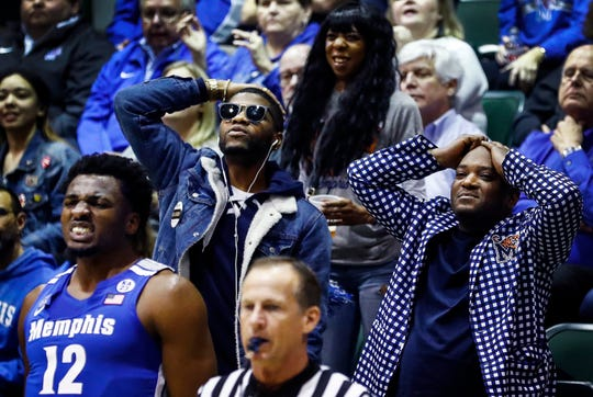 Memphis fans look on as the Tigers pull out a 83-79 victory over Tulane on Sunday. The game was an intimate experience for spectators with an announced attendance of just over 1,100 people in New Orleans.