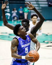 Memphis guard Kareem Brewton Jr. (front) is fouled while driving the lane against Tulane defender Bul Ajang (back) during action in New Orleans, Sunday, January 13, 2019.