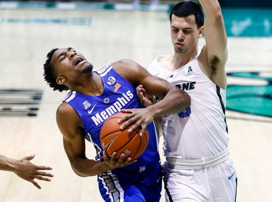 Memphis guard Jeremiah Martin (left) is fouled by Tulane defender Connor Crabtree (right) during action in New Orleans, Sunday, January 13, 2019.