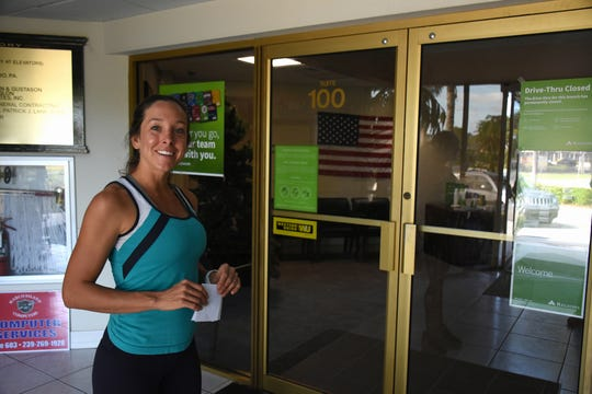 Breanne Yacono of Marco Island finds out she won't be able to do her banking on this particular Saturday. The Regions Bank branch on Marco Isand has eliminated Saturday hours and permanently closed its drive-through windows.