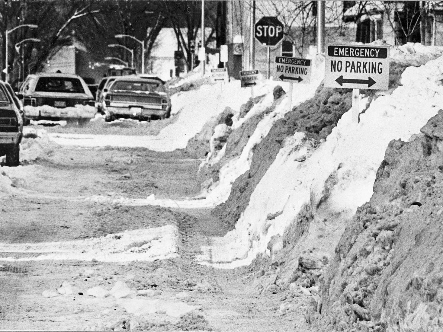 Signs punctuate snowbanks on Lapham Street near 74th Street in West Allis, where crews were preparing to remove snow from the street on Jan. 29, 1979. The Milwaukee area was still digging out from a snowstorm that dumped more than 10 inches of snow five days earlier - the third such snowstorm in less than a month. This photo was published in the Jan. 30, 1979, Milwaukee Journal.