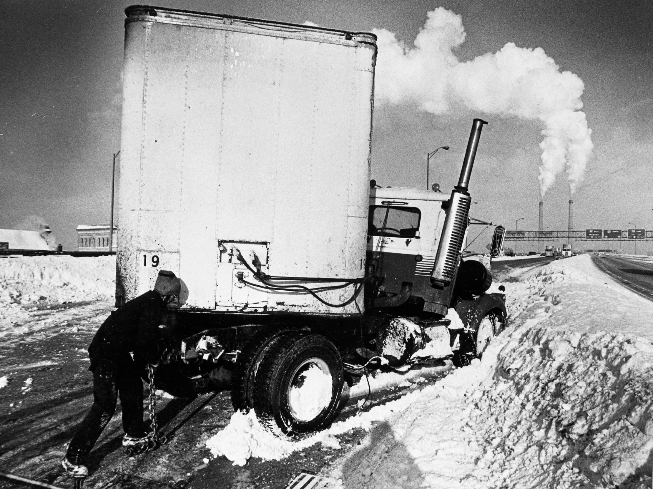 A man takes a look at a semi-trailer that jackknifed on the ice on the High Rise Bridge on I-94 on Jan. 16, 1979. No one was injured in the accident. After a snowstorm dumped more than 14 inches of snow on Milwaukee, the city was hit by a brutal cold snap, with below-zero temperatures and wind chills as low as 50 below. This photo was published in the Jan. 17, 1979, Milwaukee Journal.