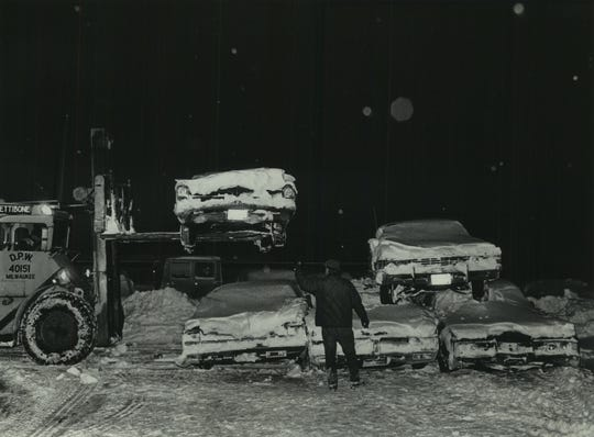 In an attempt to clear Milwaukee's snow- and car-clogged streets in mid-January 1979, the city began towing abandoned vehicles to storage lots around Milwaukee. When they began running out of room, workers began stacking the vehicles on top of each other, like at this storage lot on the city's Northwest Side on Jan. 19, 1979. This photo was published on the front page of the Jan. 20, 1979, Milwaukee Sentinel.