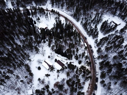 This aerial photo shows the cabin where 13-year-old  Jayme Closs was held by Jake Thomas Patterson, is surrounded by law enforcement vehicles, Saturday, Jan. 12, 2019 in the town Gordon, Wis.  Jayme had been missing for nearly three months Thursday, Jan. 10,  when she approached a stranger near the small, isolated north woods town of Gordon and pleaded for help . Officers arrested 21-year-old Jake Thomas Patterson minutes later based on Jayme's description of his vehicle. He was jailed on suspicion of kidnapping and homicide.