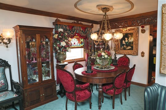 Jennifer Wissing had the dining room chairs reupholstered in sculptured velvet damask.