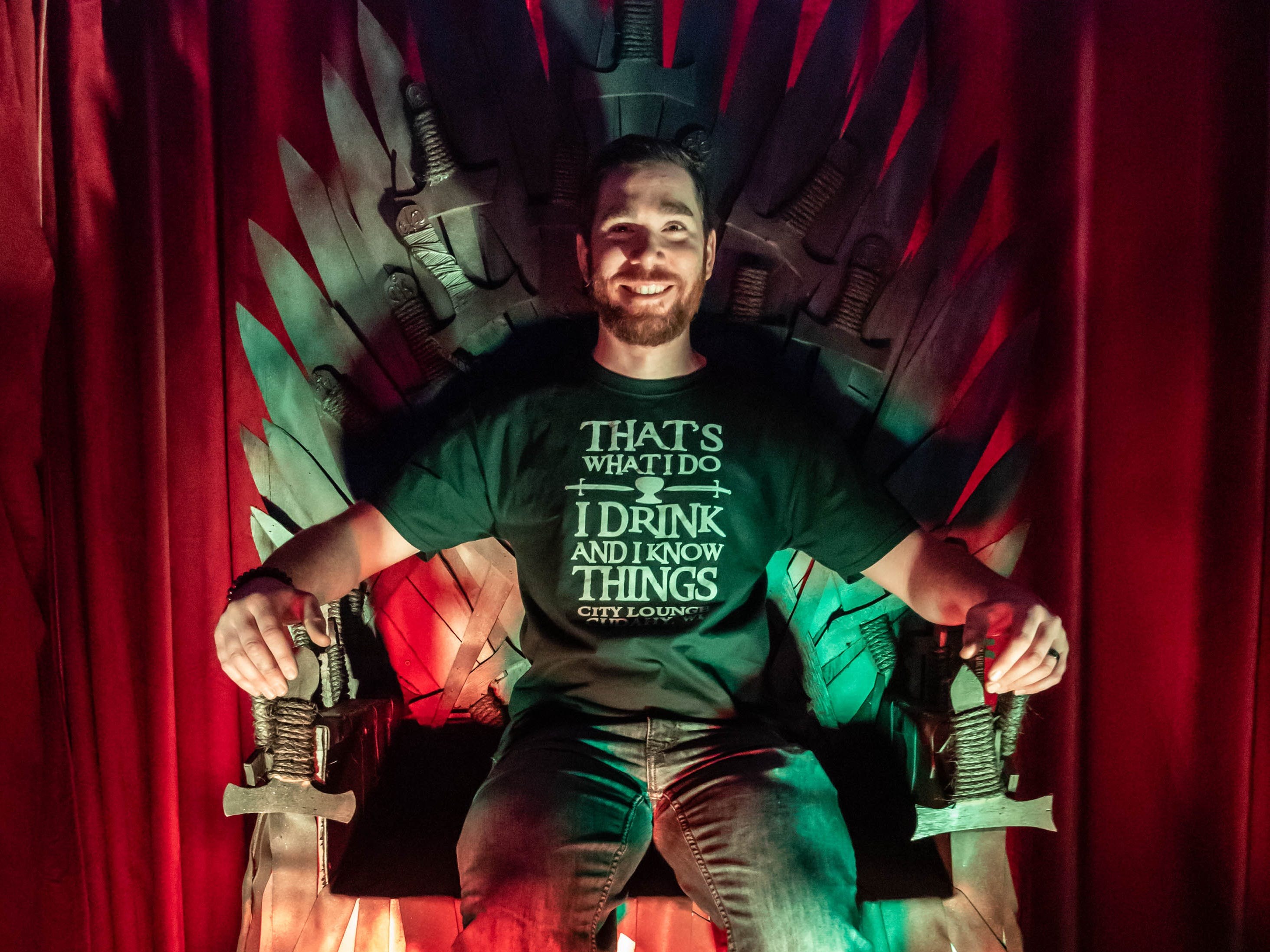 "City Lounge owner Alex Ahmad takes possession of the Iron Throne during the Cudahy tavern's ""Winter is Coming"" pop-up bar experience on Saturday, Jan. 12, 2019. The ""Game of Thrones"" inspired attraction runs through Feb. 2 and features drink specials, White Walkers, ravens and a fire breathing dragon. Attendees must be 21 or older."