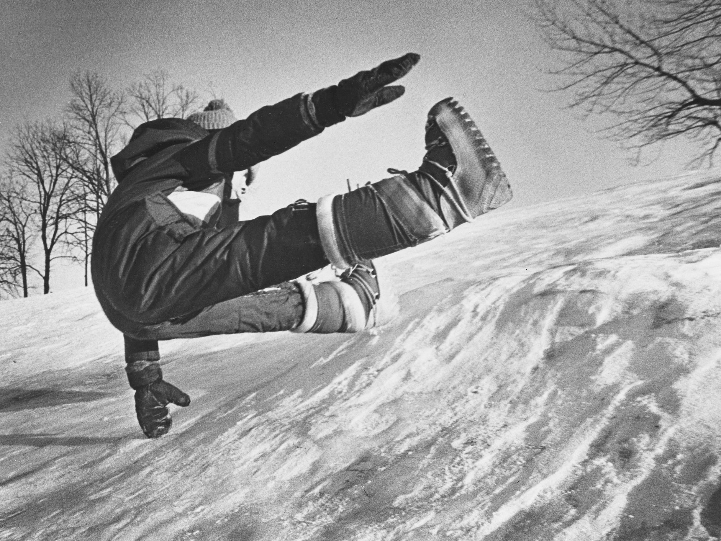 A child flies down a snow-covered hill in Menomonee Falls, near MacArthur Drive along the Menomonee River Parkway, after the Milwaukee area began digging out from under its second major snowstorm in a month in January 1979. This photo was published in the Jan. 18, 1979, Milwaukee Journal.
