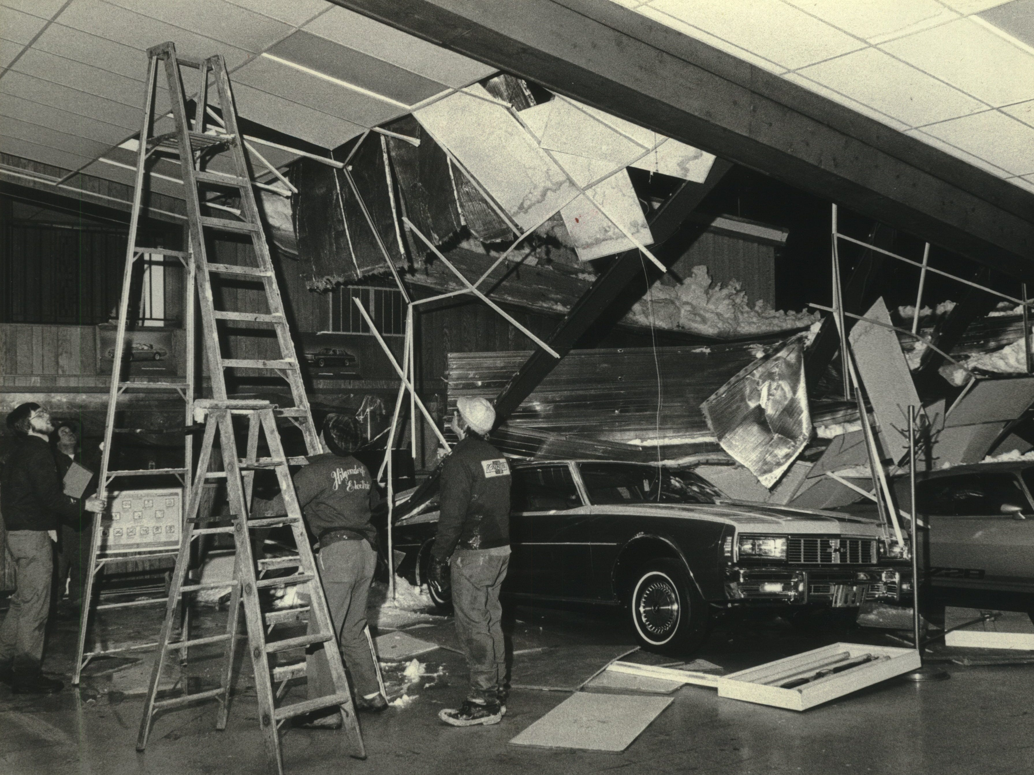 The weight of back-to-back blizzards was too much for the roof of Martz Chevrolet in Menomonee Falls. The roof of the dealership caved in on Jan. 16, 1979. This photo was published in the Jan. 17, 1979, Milwaukee Sentinel.
