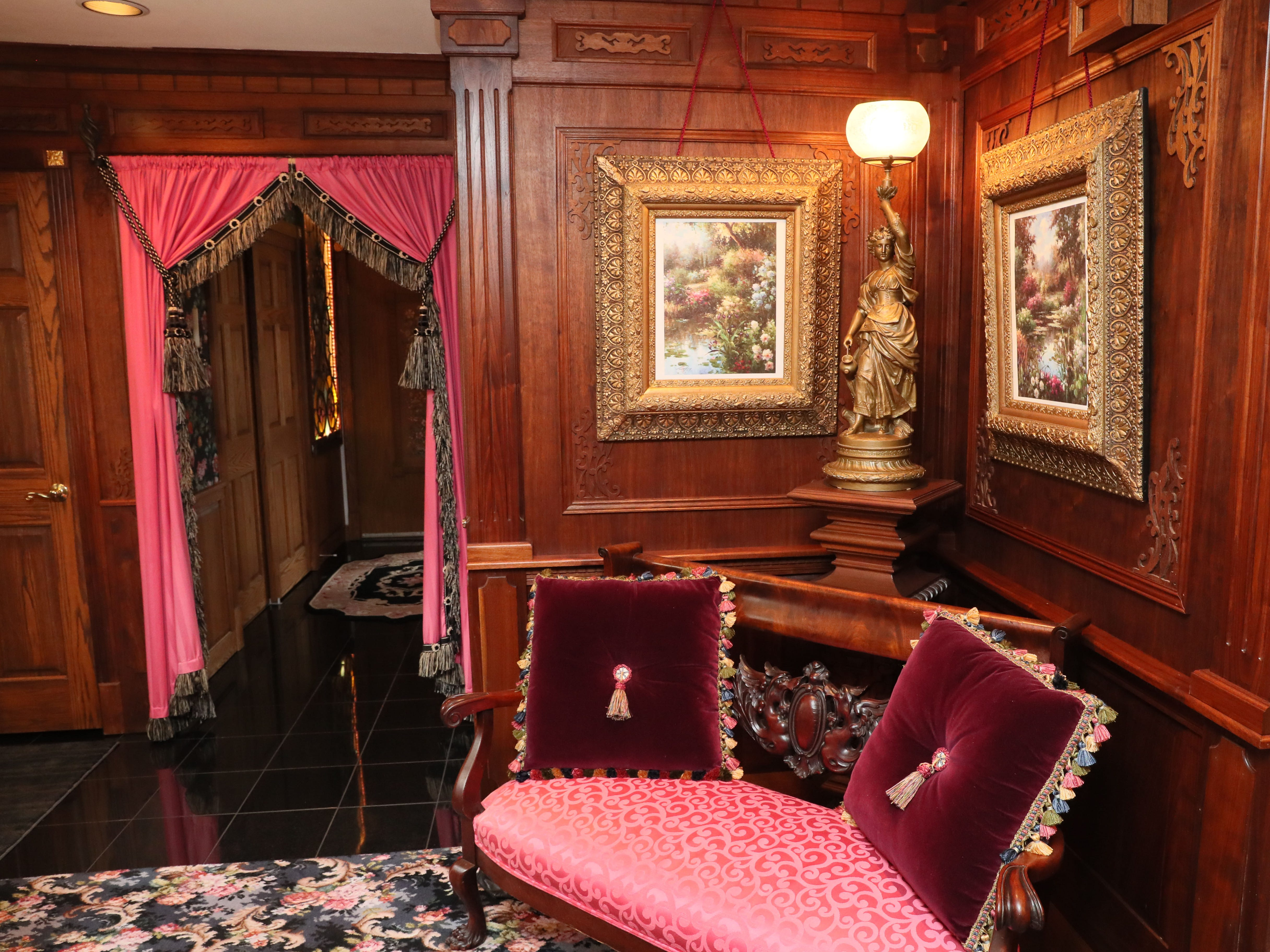 Victorian colors, like this red, were used throughout the home. Jim Wissing built the wood wall panels.