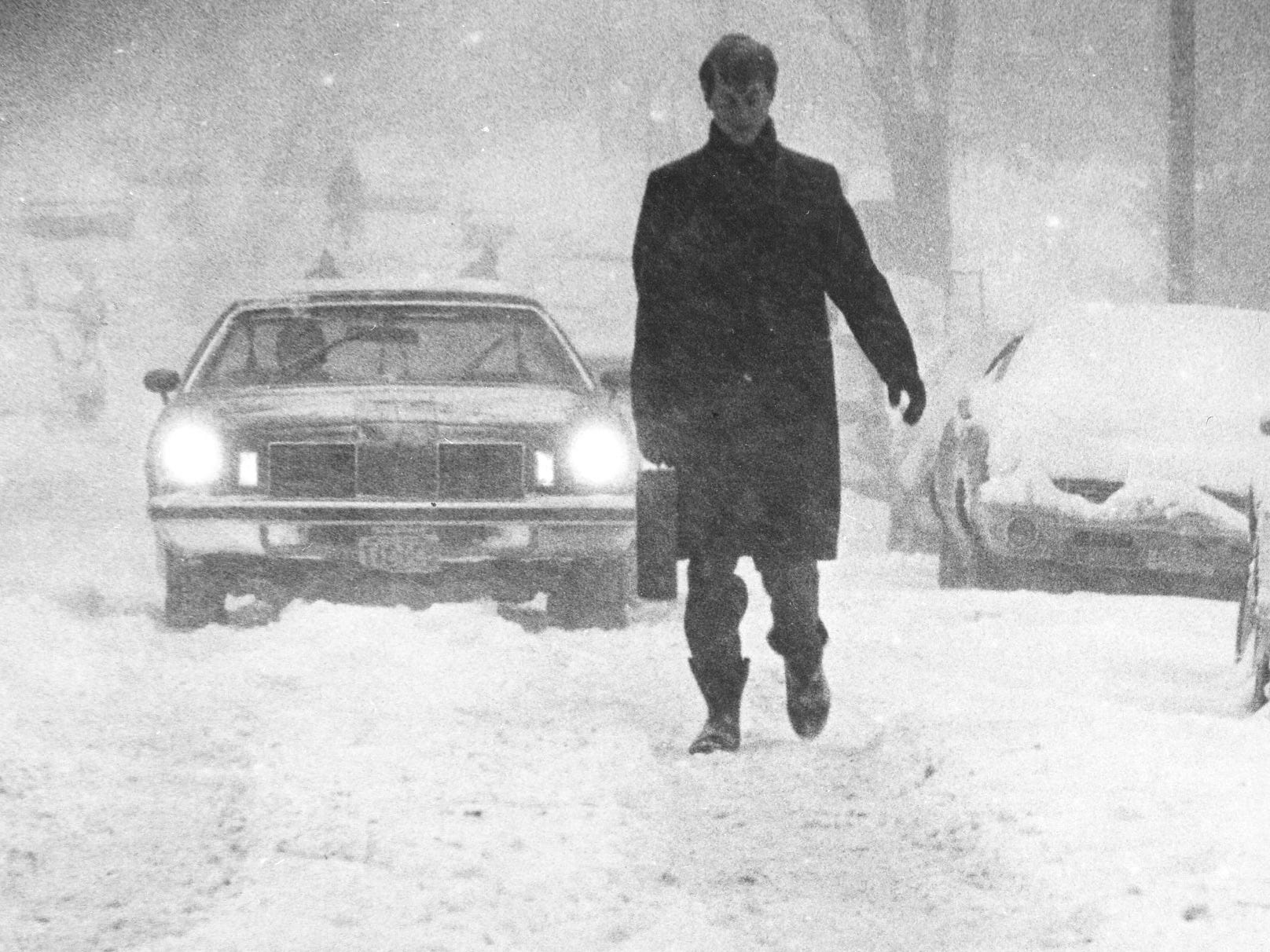 Briefcase in hand, Thomas Wilson II shares North Marshall Street with downtown morning-rush traffic on Jan. 24, 1979. That morning, Milwaukee got its third major snowstorm in less than a month. This photo was published in the Jan. 24, 1979, Milwaukee Journal.