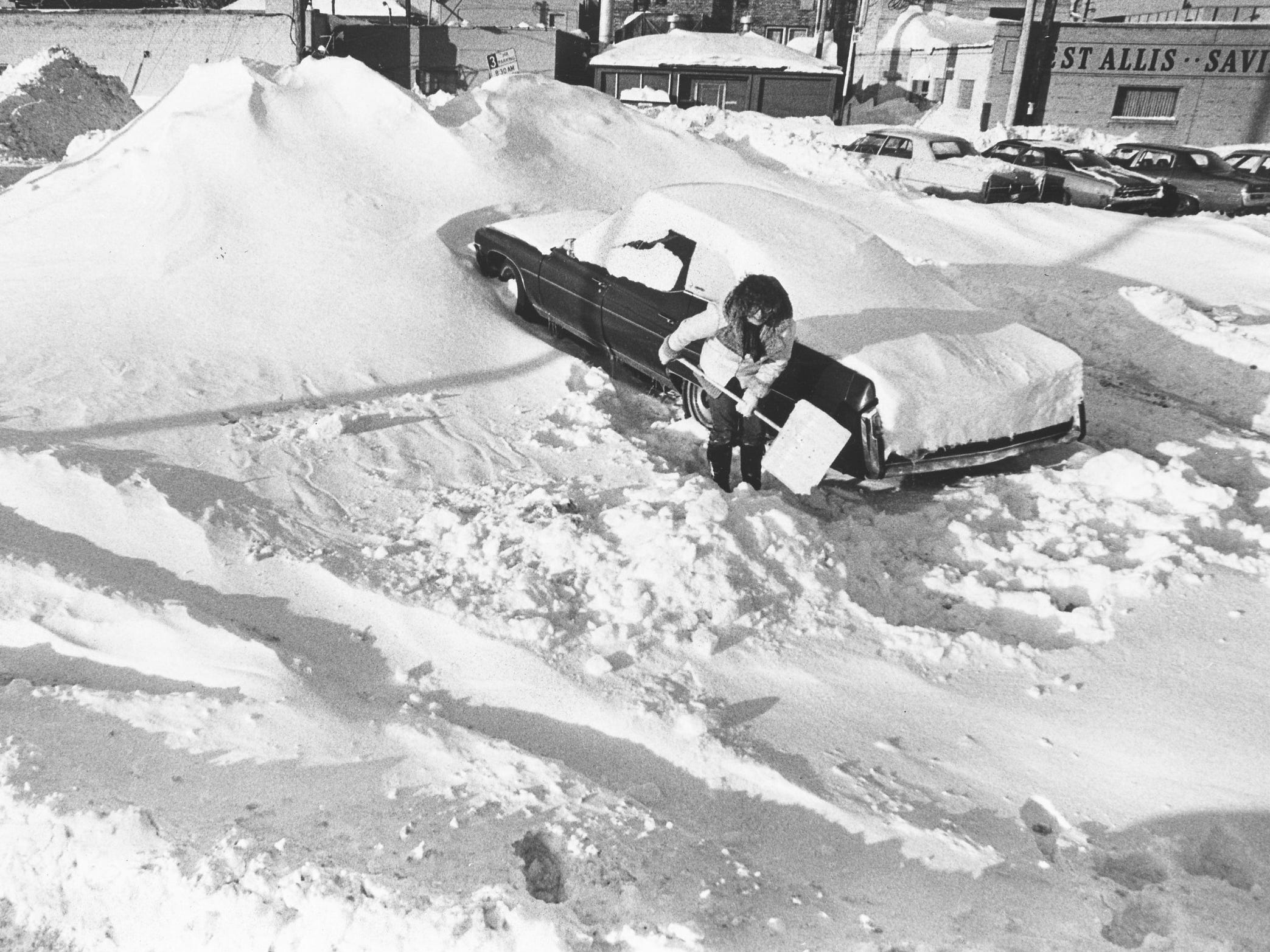 Susie Trudell of West Allis tries to clear a path for her car in a public parking lot at South 74th Street and Greenfield Avenue in West Allis on Jan. 29, 1979. This photo was published in the Jan. 30, 1979, Milwaukee Journal.