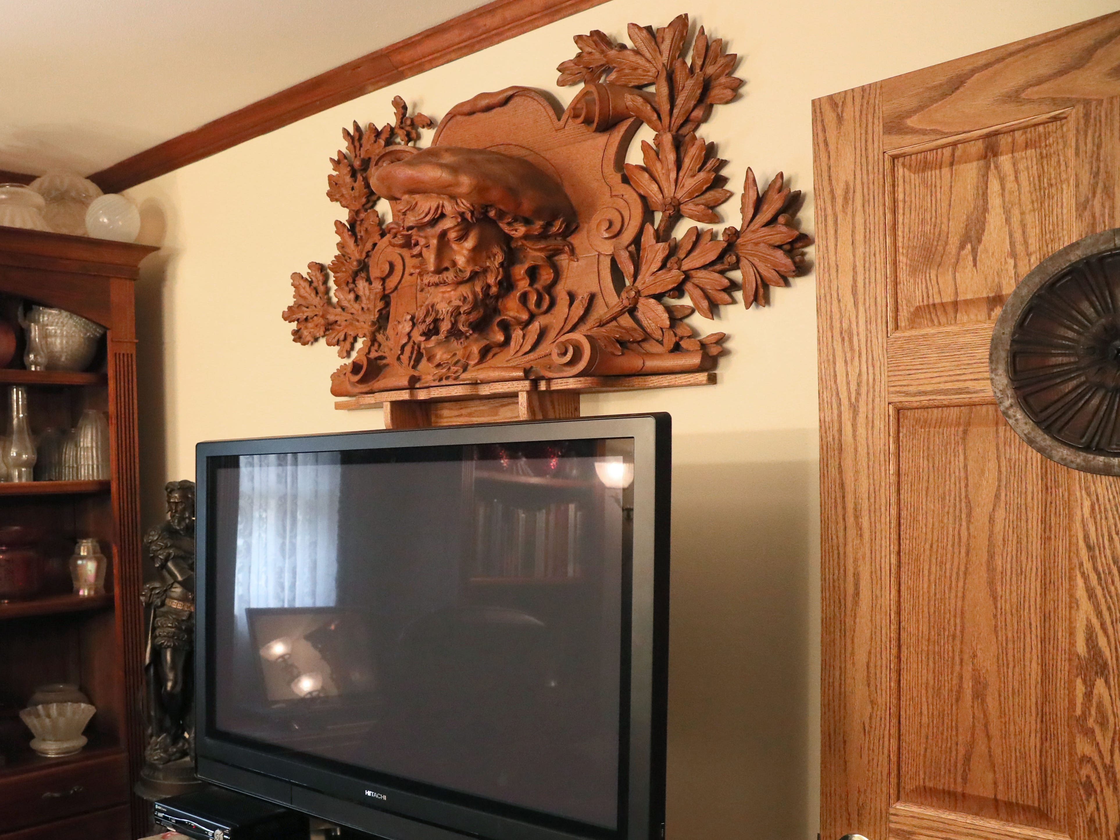 This elaborate carving above the TV in the den came from the Shandein Mansion at North 24th Street and West Wisconsin Avenue.