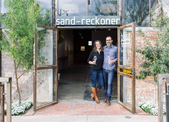 Rob and Sarah Hammelman stand in the doorway of their Tucson tasting room.