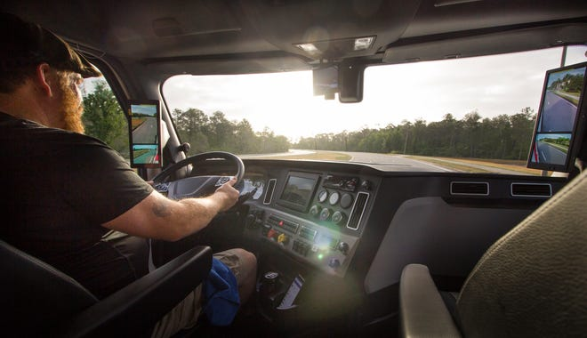 A driver takes the wheel of a semi-truck that uses cameras and digital display monitors instead of rear-view mirrors. The federal government recently approved use of the technology, which advocates say reduces blind spots and boosts fuel economy.