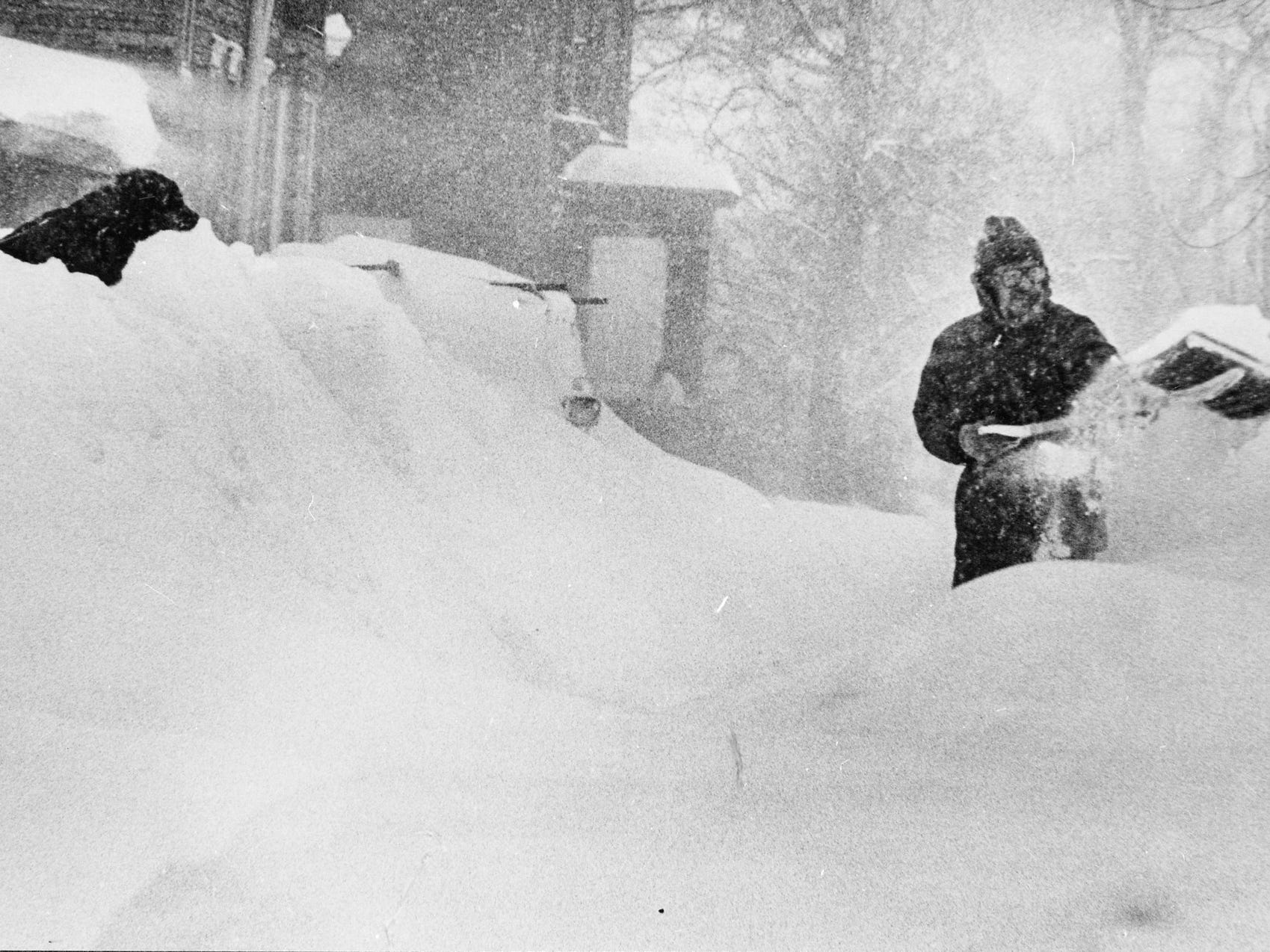 Mike Nolan gets some moral support from his dog, Oliver, as he shovels out from yet another snowstorm on Jan. 24, 1979, on West Park Hill Avenue. The storm piled onto the already 33 inches of snow on the ground, thanks largely to  two blizzards that each dumped more than 14 inches of snow on Milwaukee. This photo was published in the Jan. 24, 1979, Milwaukee Journal.