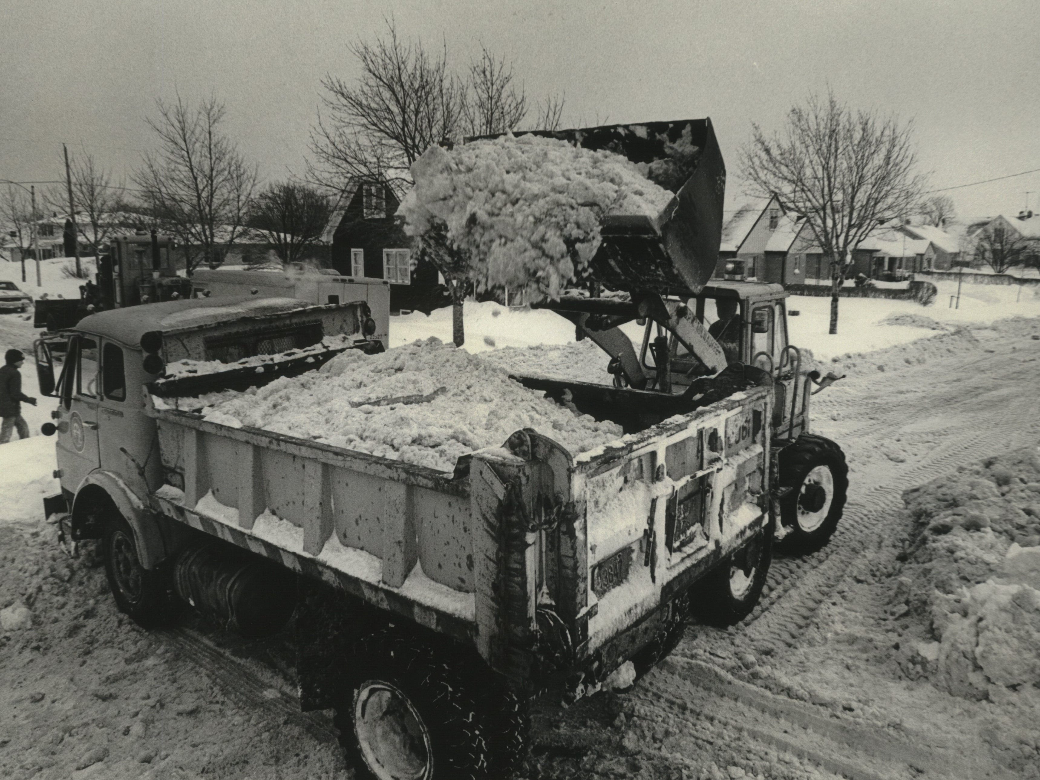 A city crew removes snow Wednesday from the blocked intersection of Quincy and Cudahy streets on Milwaukee's south side on Jan. 18, 1979. This photo was published in the Jan. 18, 1979, Milwaukee Journal.